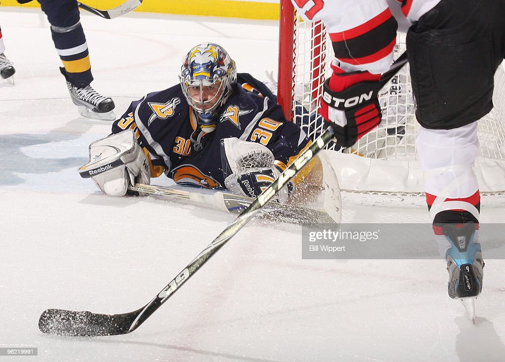 <a gi-track='captionPersonalityLinkClicked' href=/galleries/search?phrase=Ryan+Miller+-+Ice+Hockey+Player&family=editorial&specificpeople=206960 ng-click='$event.stopPropagation()'>Ryan Miller</a> #30 of the Buffalo Sabres keeps an eye on the puck before <a gi-track='captionPersonalityLinkClicked' href=/galleries/search?phrase=Zach+Parise&family=editorial&specificpeople=213606 ng-click='$event.stopPropagation()'>Zach Parise</a> #9 of the New Jersey Devils takes a second period shot on January 27, 2010 at HSBC Arena in Buffalo, New York.