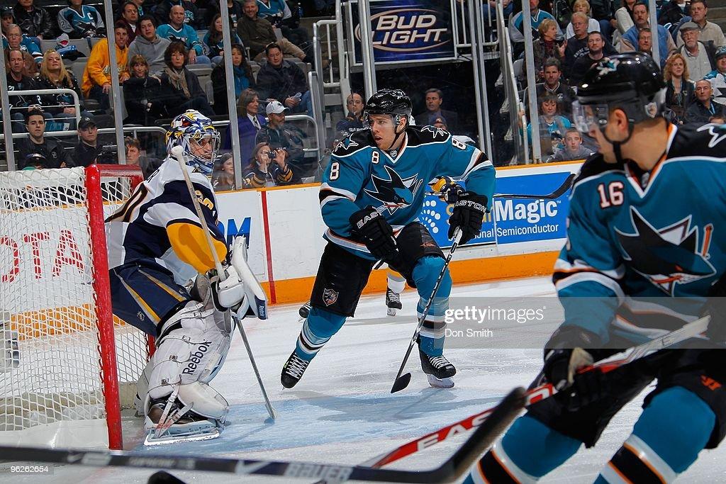 Ryan Miller #30 of the Buffalo Sabres keeps his eyes on the swarming Joe Pavelski #8 and Devin Setoguchi #16 of the San Jose Sharks during an NHL game on January 23, 2010 at HP Pavilion at San Jose in San Jose, California.