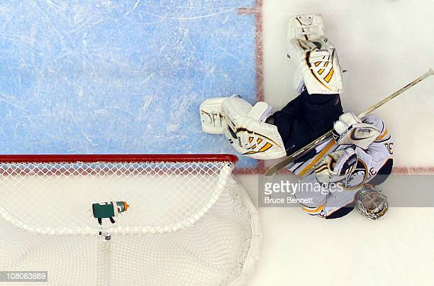Ryan Miller of the Buffalo Sabres lays on the ice following a collision with Luke Adam and a goal by Michael Grabner of the New York Islanders at the...