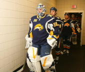 Ryan Miller of the Buffalo Sabres leads his team to the ice to play against the Ottawa Senators on December 26 2009 at HSBC Arena in Buffalo New York