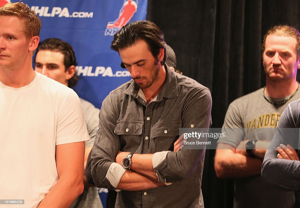Ryan Miller of the Buffalo Sabres listens to the NHLPA press conference at Marriott Marquis Times Square on September 13, 2012 in New York City.