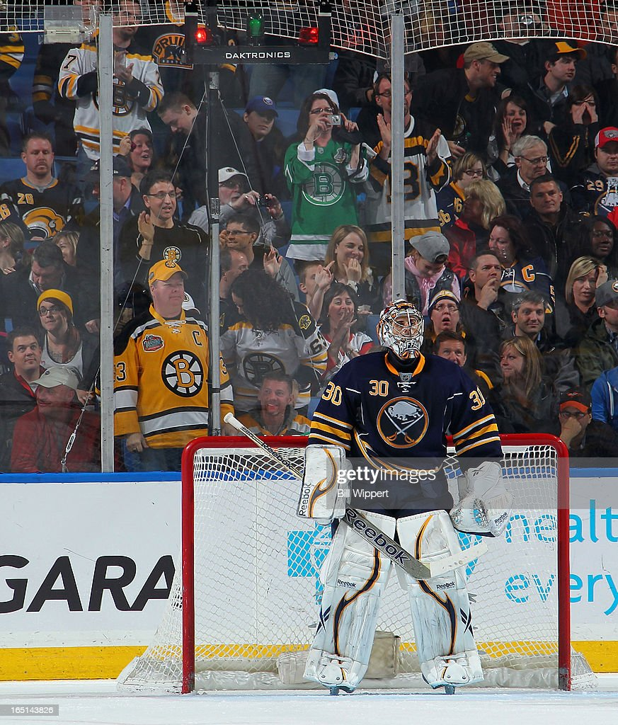Ryan Miller #30 of the Buffalo Sabres looks at the scoreboard after the Boston Bruins scored their second goal in their 2-0 victory over the Sabres on March 31, 2013 at the First Niagara Center in Buffalo, New York.