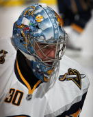 Ryan Miller of the Buffalo Sabres looks down the ice during the NHL preseason game against the Detroit Red Wings at Joe Louis Arena on September 19...