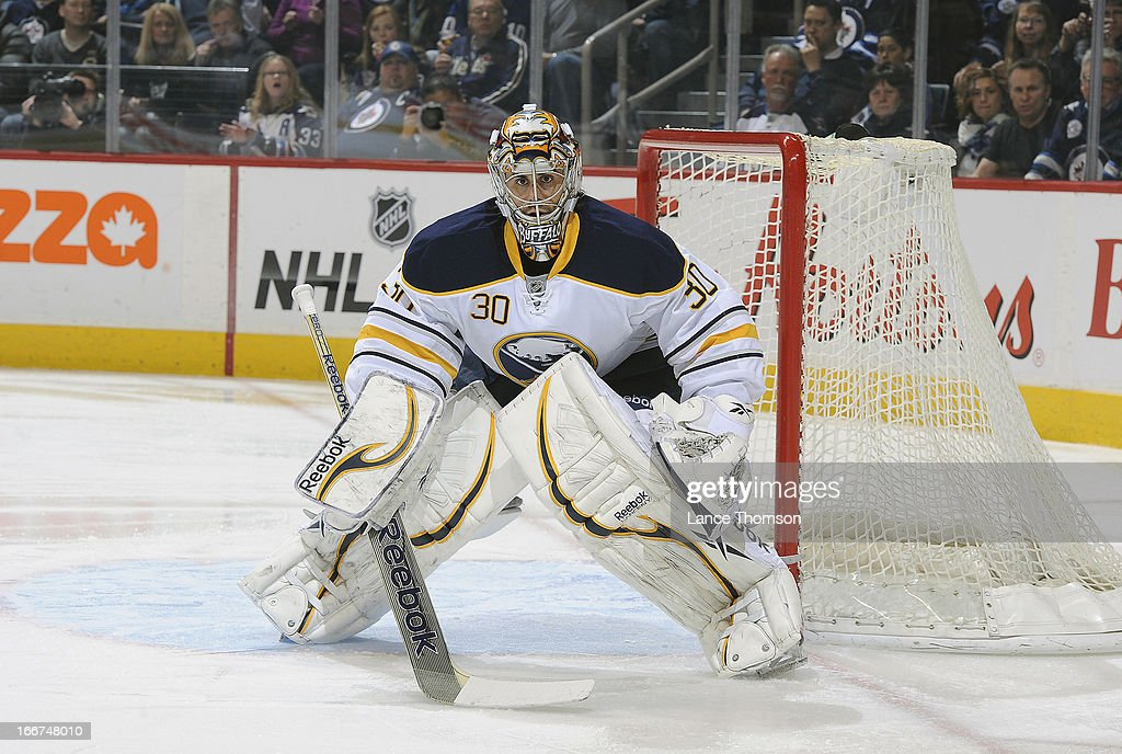 Ryan Miller #30 of the Buffalo Sabres looks on from the net during first period action against the Winnipeg Jets at the MTS Centre on April 9, 2013 in Winnipeg, Manitoba, Canada. The Jets defeated the Sabres 4-1.