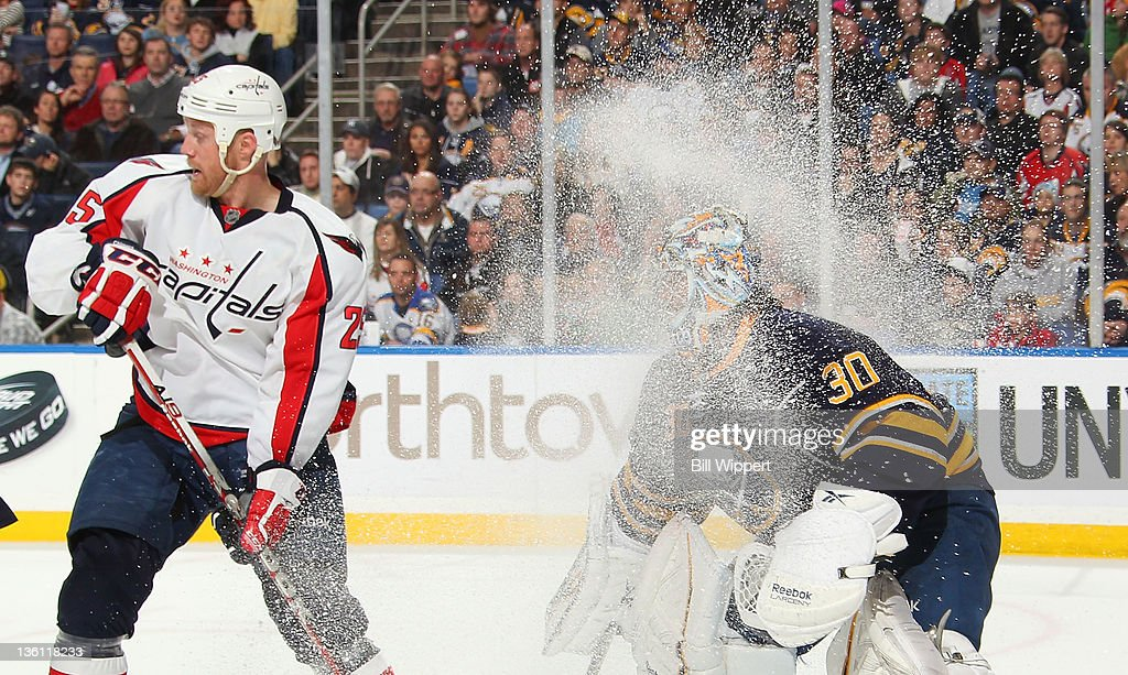 Ryan Miller #30 of the Buffalo Sabres looks through the spray of ice against <a gi-track='captionPersonalityLinkClicked' href=/galleries/search?phrase=Jason+Chimera&family=editorial&specificpeople=211264 ng-click='$event.stopPropagation()'>Jason Chimera</a> #25 of the Washington Capitals at First Niagara Center on December 26, 2011 in Buffalo, New York.