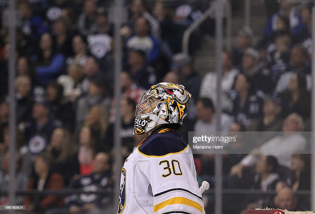 Ryan Miller #30 of the Buffalo Sabres looks up at the replay during second-period action against the Winnipeg Jets on April 9, 2013 at the MTS Centre in Winnipeg, Manitoba, Canada.