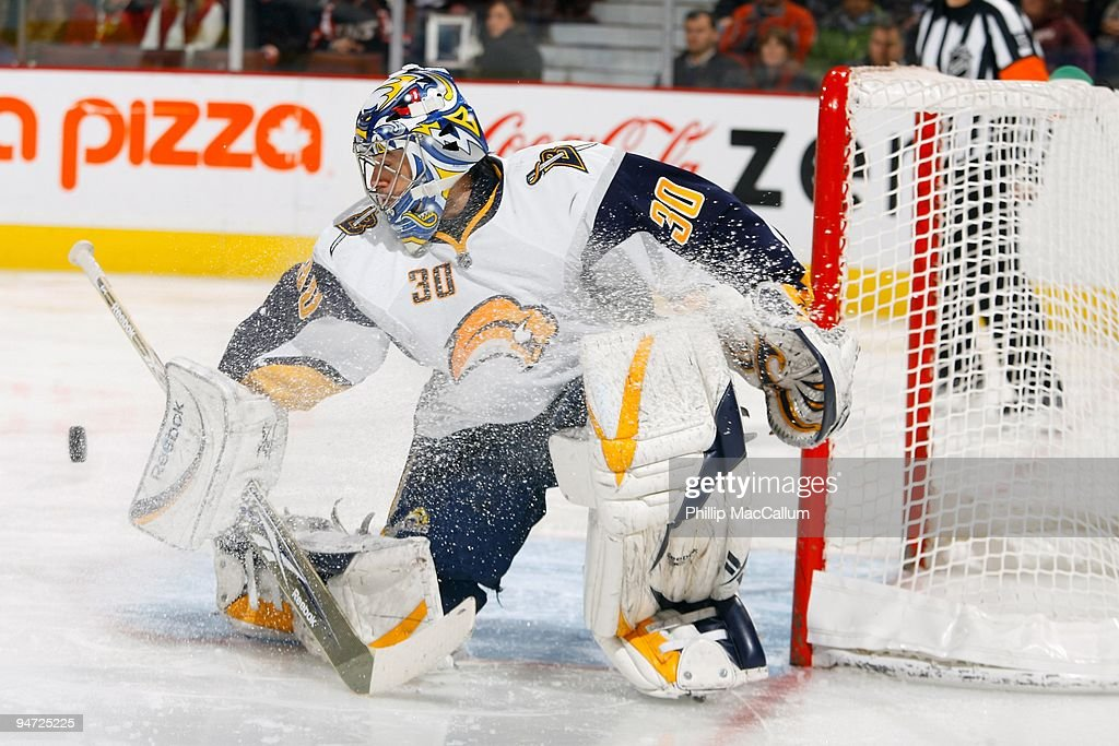 Ryan Miller of the Buffalo Sabres makes a blocker save down low during a game against the Ottawa Senators at Scotiabank Place on December 16 2009 in...