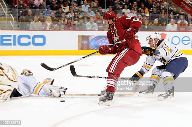 Ryan Miller of the Buffalo Sabres makes a diving save on Shane Doan of the Phoenix Coyotes on January 8 2011 at Jobingcom Arena in Glendale Arizona