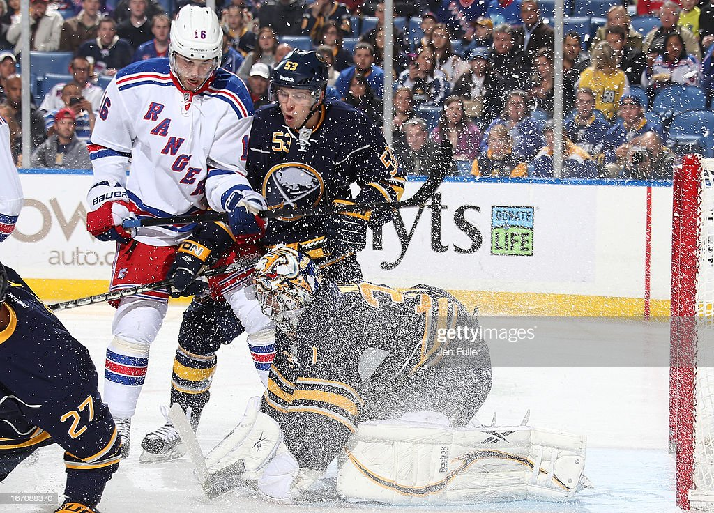 Ryan Miller #30 of the Buffalo Sabres makes a first-period save in front of teammate Mark Pysyk #53 and Derick Brassard #16 of the New York Rangers at First Niagara Center on April 19, 2013 in Buffalo, New York.