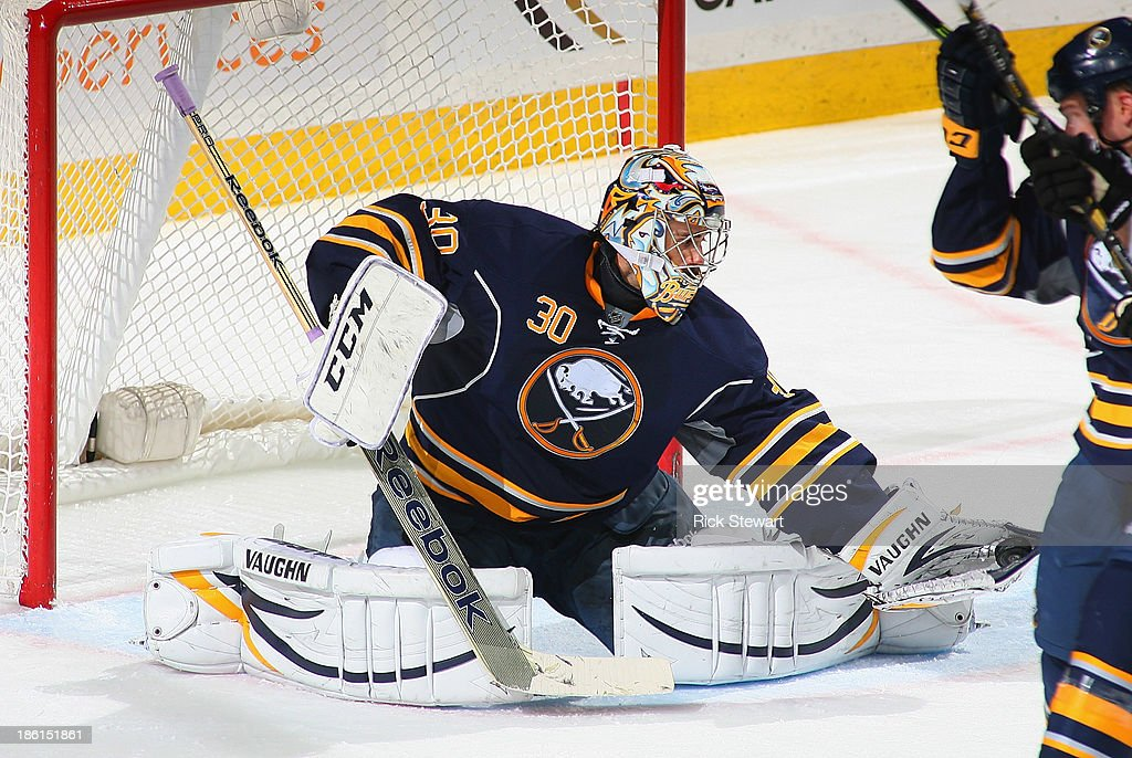 Ryan Miller #30 of the Buffalo Sabres makes a glove save in the third period against the Dallas Stars at First Niagara Center on October 28, 2013 in Buffalo, New York. Dallas won 4-3.