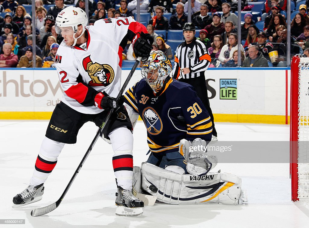 Ryan Miller #30 of the Buffalo Sabres makes a pad save as he is screened by <a gi-track='captionPersonalityLinkClicked' href=/galleries/search?phrase=Erik+Condra&family=editorial&specificpeople=6254234 ng-click='$event.stopPropagation()'>Erik Condra</a> #22 of the Ottawa Senators at First Niagara Center on December 10, 2013 in Buffalo, New York. Buffalo defeated Ottawa 2-1.