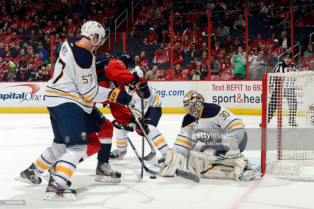 Ryan Miller #30 of the Buffalo Sabres makes a save against <a gi-track='captionPersonalityLinkClicked' href=/galleries/search?phrase=Marcus+Johansson&family=editorial&specificpeople=4247883 ng-click='$event.stopPropagation()'>Marcus Johansson</a> #90 of the Washington Capitals during the third period of an NHL game at Verizon Center on March 17, 2013 in Washington, DC.