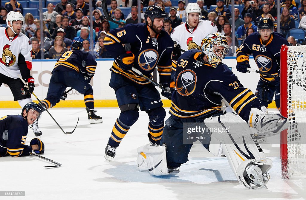 Ryan Miller #30 of the Buffalo Sabres makes a save against the Ottawa Senators alongside teammates Mike Weber #6 and Tyler Ennis #63 at First Niagara Center on October 4, 2013 in Buffalo, New York. Ottawa defeated Buffalo 1-0.
