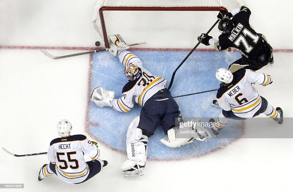 Ryan Miller #30 of the Buffalo Sabres makes a save against the Pittsburgh Penguins during the game at Consol Energy Center on April 2, 2013 in Pittsburgh, Pennsylvania. The Sabres defeated the Penguins 4-1.