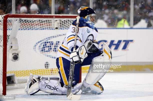Ryan Miller of the Buffalo Sabres makes a save against the Pittsburgh Penguins at the NHL Winter Classic on January 1 2008 at Ralph Wilson Stadium in...