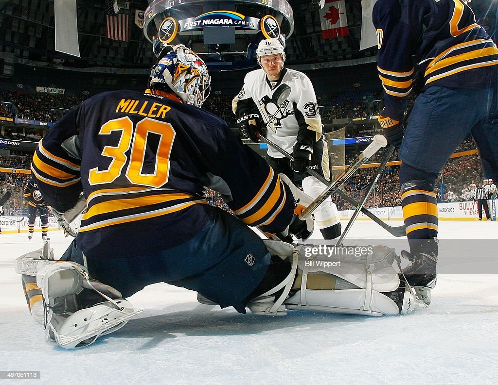 Ryan Miller #30 of the Buffalo Sabres makes a save as Jussi Jokinen #36 of the Pittsburgh Penguins looks for a rebound on February 5, 2014 at the First Niagara Center in Buffalo, New York.