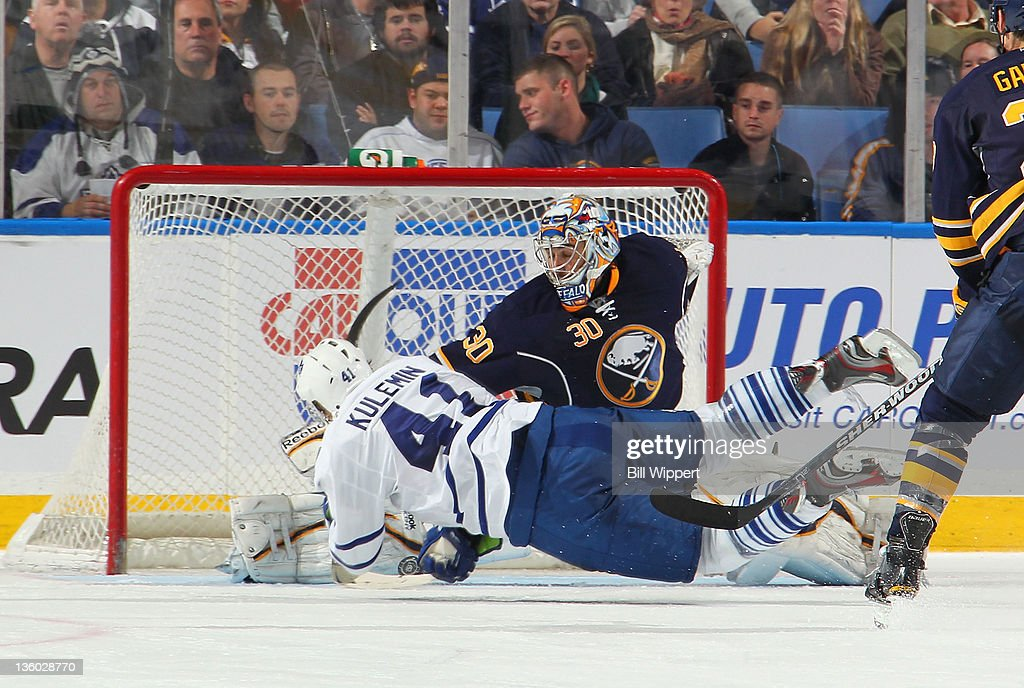 Ryan Miller #30 of the Buffalo Sabres makes a save as <a gi-track='captionPersonalityLinkClicked' href=/galleries/search?phrase=Nikolai+Kulemin&family=editorial&specificpeople=537949 ng-click='$event.stopPropagation()'>Nikolai Kulemin</a> #41 of the Toronto Maple Leafs is upended at First Niagara Center on December 16, 2011 in Buffalo, New York. A penalty shot was called on the play.