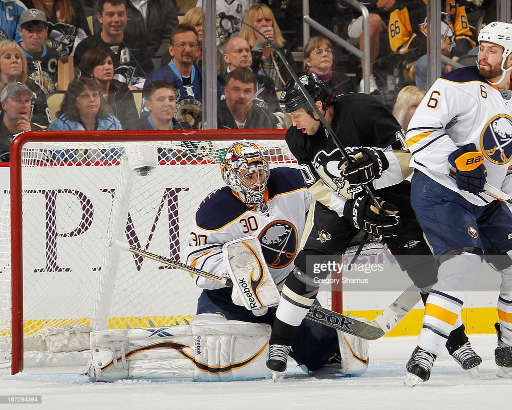 Ryan Miller #30 of the Buffalo Sabres makes a save in front of <a gi-track='captionPersonalityLinkClicked' href=/galleries/search?phrase=Brenden+Morrow&family=editorial&specificpeople=202256 ng-click='$event.stopPropagation()'>Brenden Morrow</a> #10 of the Pittsburgh Penguins and Mike Weber #6 on April 23, 2013 at Consol Energy Center in Pittsburgh, Pennsylvania.