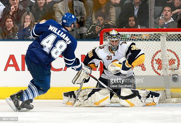 Ryan Miller of the Buffalo Sabres makes a save in the shootout on Jeremy Williams of the Toronto Maple Leafs during their NHL game at the Air Canada...