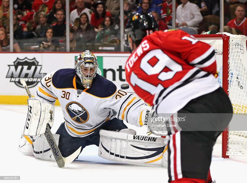 Ryan Miller #2 of the Buffalo Sabres makes a save on a shot by <a gi-track='captionPersonalityLinkClicked' href=/galleries/search?phrase=Jonathan+Toews&family=editorial&specificpeople=537799 ng-click='$event.stopPropagation()'>Jonathan Toews</a> #19 of the Chicago Blackhawks at the United Center on October 12, 2013 in Chicago, Illinois.