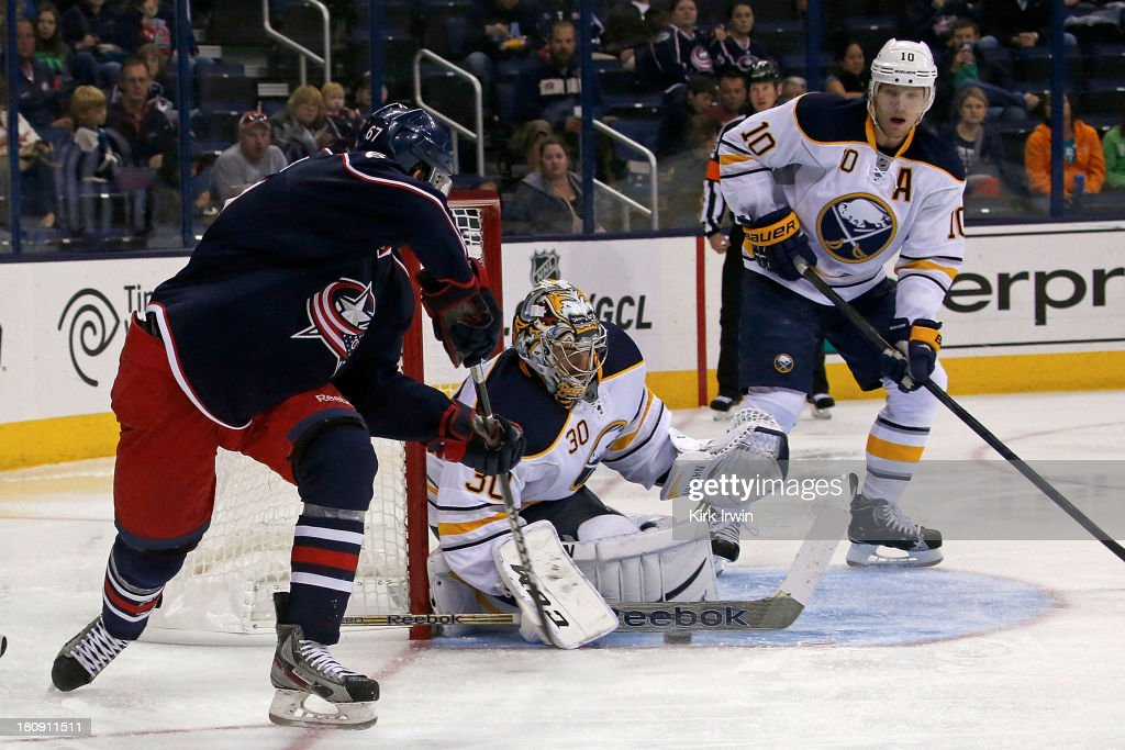 Ryan Miller #30 of the Buffalo Sabres makes a save on a wrap around attempt by <a gi-track='captionPersonalityLinkClicked' href=/galleries/search?phrase=Nick+Moutrey&family=editorial&specificpeople=8708978 ng-click='$event.stopPropagation()'>Nick Moutrey</a> #67 of the Columbus Blue Jackets during the second period on September, 2013 at Nationwide Arena in Columbus, Ohio.