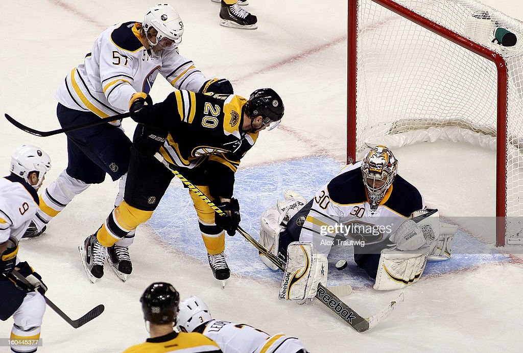 Ryan Miller #30 of the Buffalo Sabres makes a save on <a gi-track='captionPersonalityLinkClicked' href=/galleries/search?phrase=Daniel+Paille&family=editorial&specificpeople=706561 ng-click='$event.stopPropagation()'>Daniel Paille</a> #20 of the Boston Bruins in the third period during a game at the TD Garden on January 31, 2013 in Boston, Massachusetts. The Sabres defeated the Bruins 7-4.