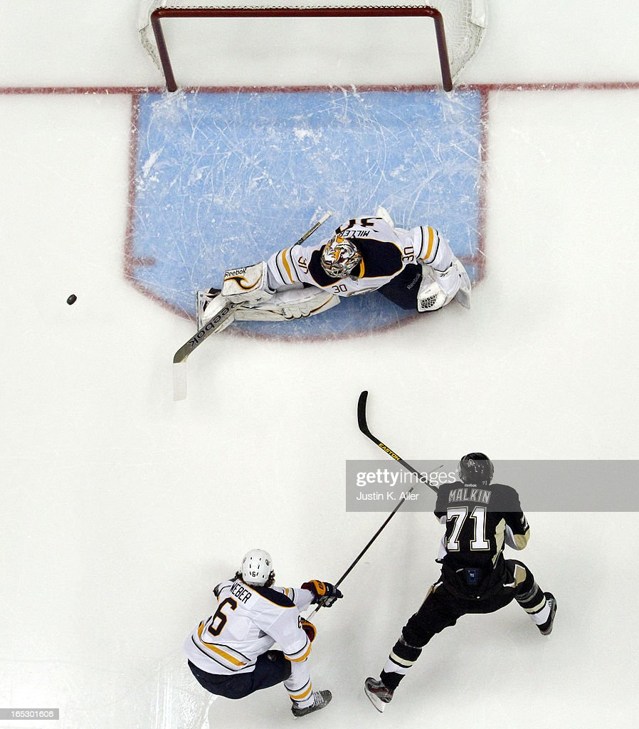 Ryan Miller #30 of the Buffalo Sabres makes a save on <a gi-track='captionPersonalityLinkClicked' href=/galleries/search?phrase=Evgeni+Malkin&family=editorial&specificpeople=221676 ng-click='$event.stopPropagation()'>Evgeni Malkin</a> #71 of the Pittsburgh Penguins during the game at Consol Energy Center on April 2, 2013 in Pittsburgh, Pennsylvania. The Sabres defeated the Penguins 4-1.