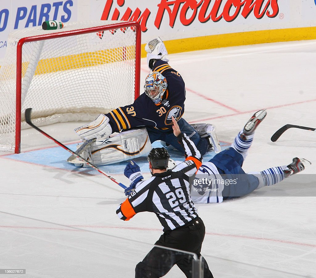 Ryan Miller #30 of the Buffalo Sabres makes a save on <a gi-track='captionPersonalityLinkClicked' href=/galleries/search?phrase=Nikolai+Kulemin&family=editorial&specificpeople=537949 ng-click='$event.stopPropagation()'>Nikolai Kulemin</a> #41 of the Toronto Maple Leafs as referee Ian Walsh #29 calls a penalty at First Niagara Center on December 16, 2011 in Buffalo, New York. Kulemin was awarded a penalty shot and scored. Buffalo won 5-4.