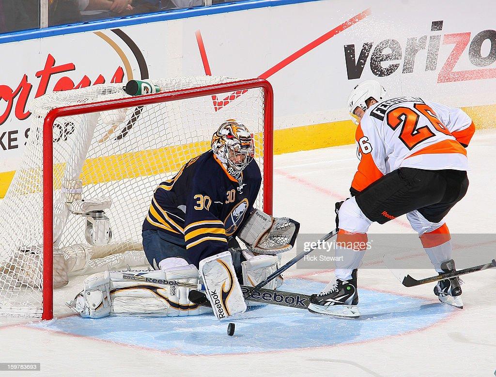 Ryan Miller #30 of the Buffalo Sabres makes a save on Ruslan Fedotenko #26 of the Philadelphia Flyers at First Niagara Center on January 20, 2013 in Buffalo, United States. Buffalo won 5-2.