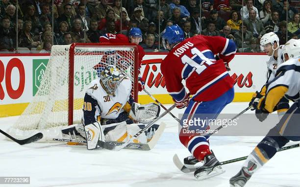 Ryan Miller of the Buffalo Sabres makes a save on Saku Koivu of the Montreal Canadiens during their NHL game at the Bell Centre November 5 2007 in...