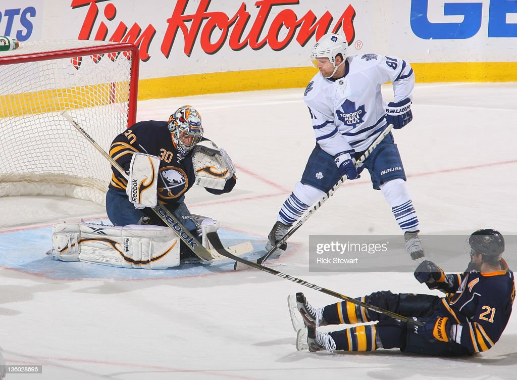 Ryan Miller #30 of the Buffalo Sabres makes a save with <a gi-track='captionPersonalityLinkClicked' href=/galleries/search?phrase=Phil+Kessel&family=editorial&specificpeople=537794 ng-click='$event.stopPropagation()'>Phil Kessel</a> #81 of the Toronto Maple Leafs looking for a rebound and <a gi-track='captionPersonalityLinkClicked' href=/galleries/search?phrase=Drew+Stafford&family=editorial&specificpeople=220617 ng-click='$event.stopPropagation()'>Drew Stafford</a> #21 of the Buffalo Sabres sitting out in front at First Niagara Center on December 16, 2011 in Buffalo, New York.