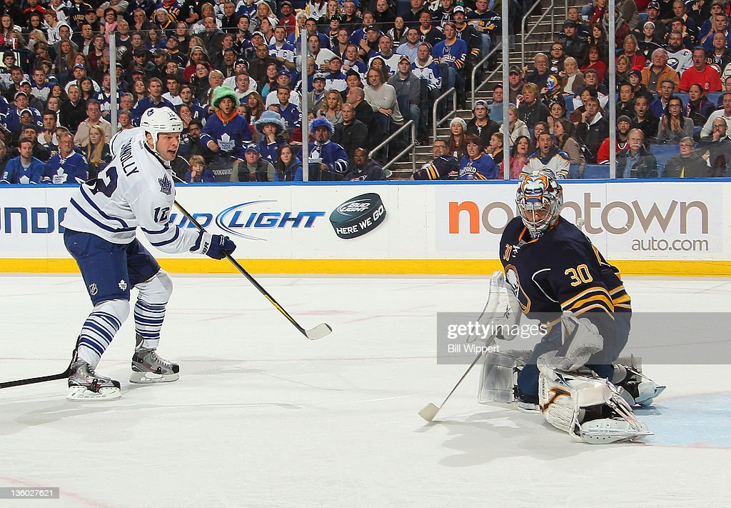 Ryan Miller #30 of the Buffalo Sabres makes a second period save against <a gi-track='captionPersonalityLinkClicked' href=/galleries/search?phrase=Tim+Connolly&family=editorial&specificpeople=208158 ng-click='$event.stopPropagation()'>Tim Connolly</a> #12 of the Toronto Maple Leafs at First Niagara Center on December 16, 2011 in Buffalo, New York.