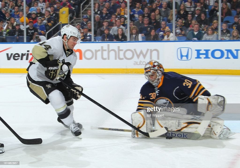 Ryan Miller #30 of the Buffalo Sabres makes a second period save against Chris Kunitz #14 of the Pittsburgh Penguins on February 17, 2013 at the First Niagara Center in Buffalo, New York.