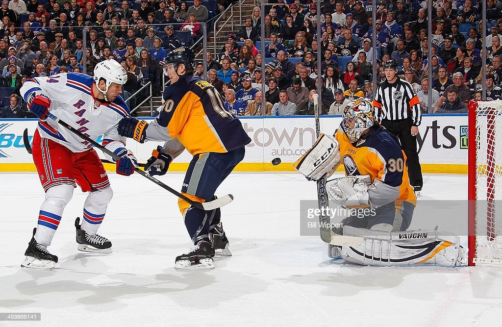 Ryan Miller #30 of the Buffalo Sabres makes a second period save as teammate <a gi-track='captionPersonalityLinkClicked' href=/galleries/search?phrase=Christian+Ehrhoff&family=editorial&specificpeople=214788 ng-click='$event.stopPropagation()'>Christian Ehrhoff</a> #10 defends <a gi-track='captionPersonalityLinkClicked' href=/galleries/search?phrase=Taylor+Pyatt&family=editorial&specificpeople=204508 ng-click='$event.stopPropagation()'>Taylor Pyatt</a> #14 of the New York Rangers on December 5, 2013 at the First Niagara Center in Buffalo, New York.