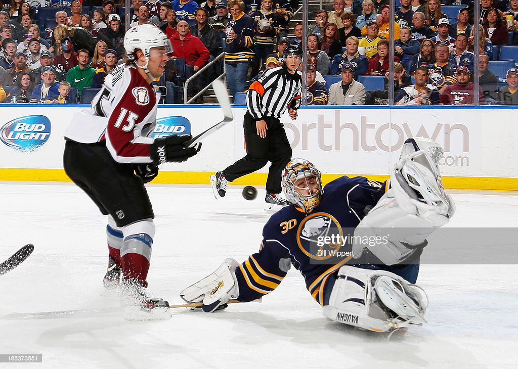 Ryan Miller #30 of the Buffalo Sabres makes a sliding save against PA Parenteau #15 of the Colorado Avalanche on October 19, 2013 at the First Niagara Center in Buffalo, New York.