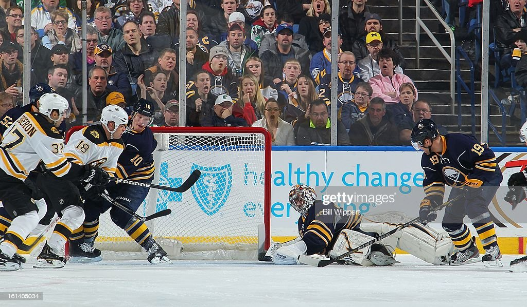 Ryan Miller #30 of the Buffalo Sabres makes a sprawling save alongside teammates <a gi-track='captionPersonalityLinkClicked' href=/galleries/search?phrase=Christian+Ehrhoff&family=editorial&specificpeople=214788 ng-click='$event.stopPropagation()'>Christian Ehrhoff</a> #10 and <a gi-track='captionPersonalityLinkClicked' href=/galleries/search?phrase=Cody+Hodgson&family=editorial&specificpeople=4151192 ng-click='$event.stopPropagation()'>Cody Hodgson</a> #19 to keep the puck away from <a gi-track='captionPersonalityLinkClicked' href=/galleries/search?phrase=Patrice+Bergeron&family=editorial&specificpeople=204162 ng-click='$event.stopPropagation()'>Patrice Bergeron</a> #37 and <a gi-track='captionPersonalityLinkClicked' href=/galleries/search?phrase=Nathan+Horton&family=editorial&specificpeople=204741 ng-click='$event.stopPropagation()'>Nathan Horton</a> #18 of the Boston Bruins on February 10, 2013 at the First Niagara Center in Buffalo, New York.