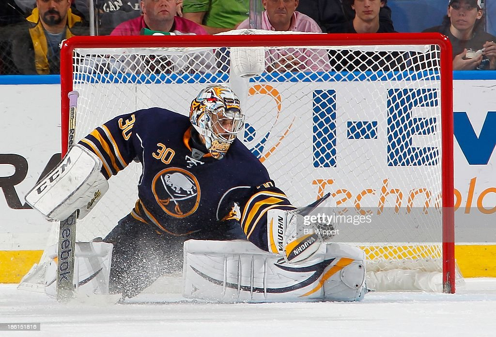 Ryan Miller #30 of the Buffalo Sabres makes a third period glove save against the Dallas Stars on October 28, 2013 at the First Niagara Center in Buffalo, New York.