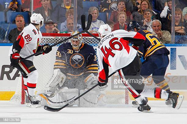 Ryan Miller of the Buffalo Sabres makes a thirdperiod save on a shot from Patrick Wiercioch of the Ottawa Senators with Cory Conacher of the Senators...