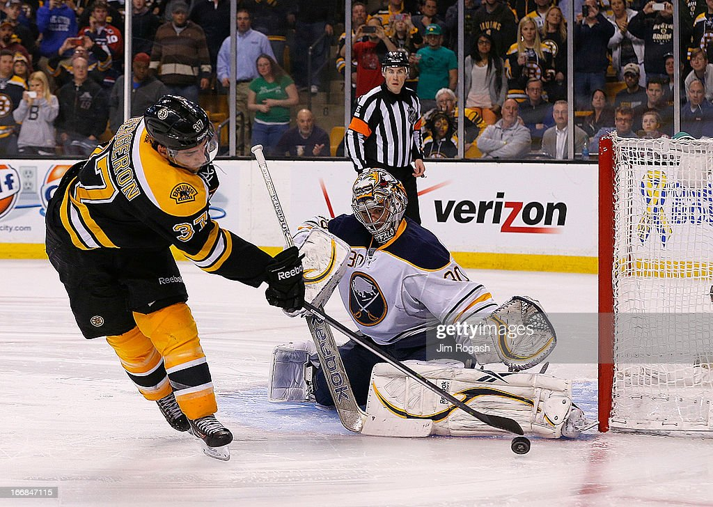 Ryan Miller #30 of the Buffalo Sabres makes the save on a shot by <a gi-track='captionPersonalityLinkClicked' href=/galleries/search?phrase=Patrice+Bergeron&family=editorial&specificpeople=204162 ng-click='$event.stopPropagation()'>Patrice Bergeron</a> #37 of the Boston Bruins in an overtime shootout at TD Garden on April 17, 2013 in Boston, Massachusetts.