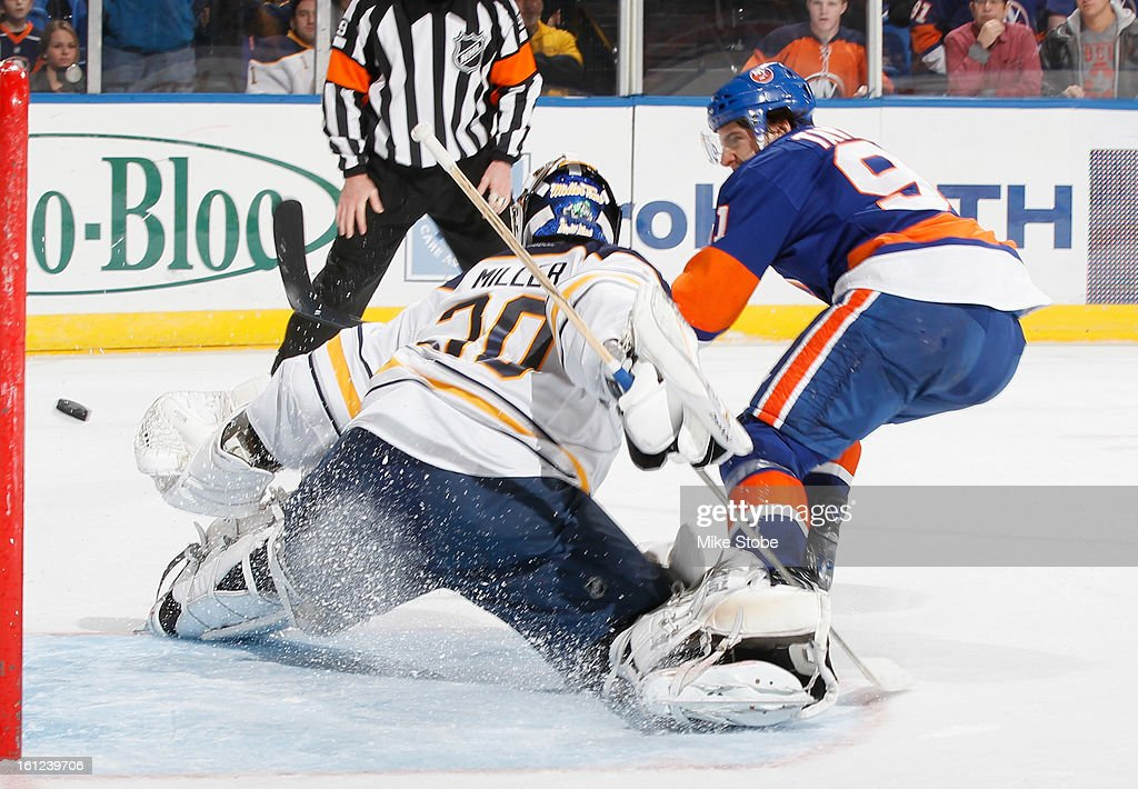 Ryan Miller #30 of the Buffalo Sabres protects the net against John Tavares #91 of the New York Islanders during a penatly shot at Nassau Veterans Memorial Coliseum on February 9, 2013 in Uniondale, New York. The Sabres defeated the Islanders 3-2.
