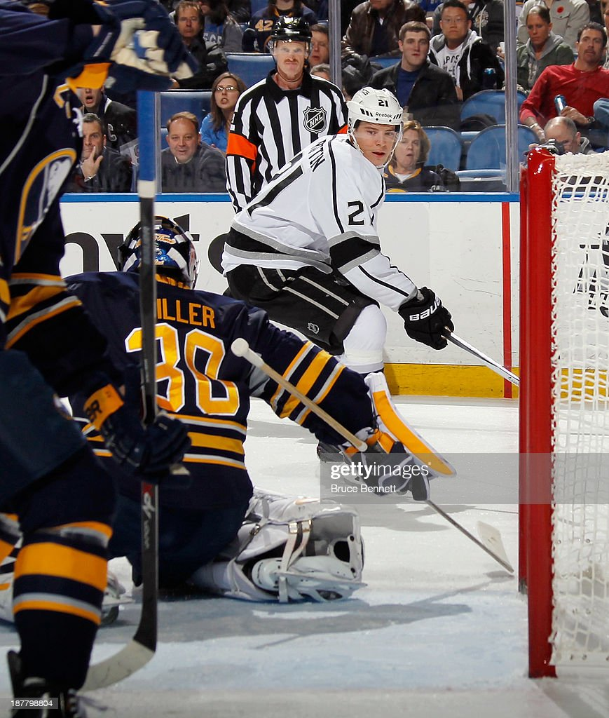 Ryan Miller #30 of the Buffalo Sabres reaches back to make the save on Matt Frattin #21 of the Los Angeles Kings during the first period at the First Niagara Center on November 12, 2013 in Buffalo, New York.