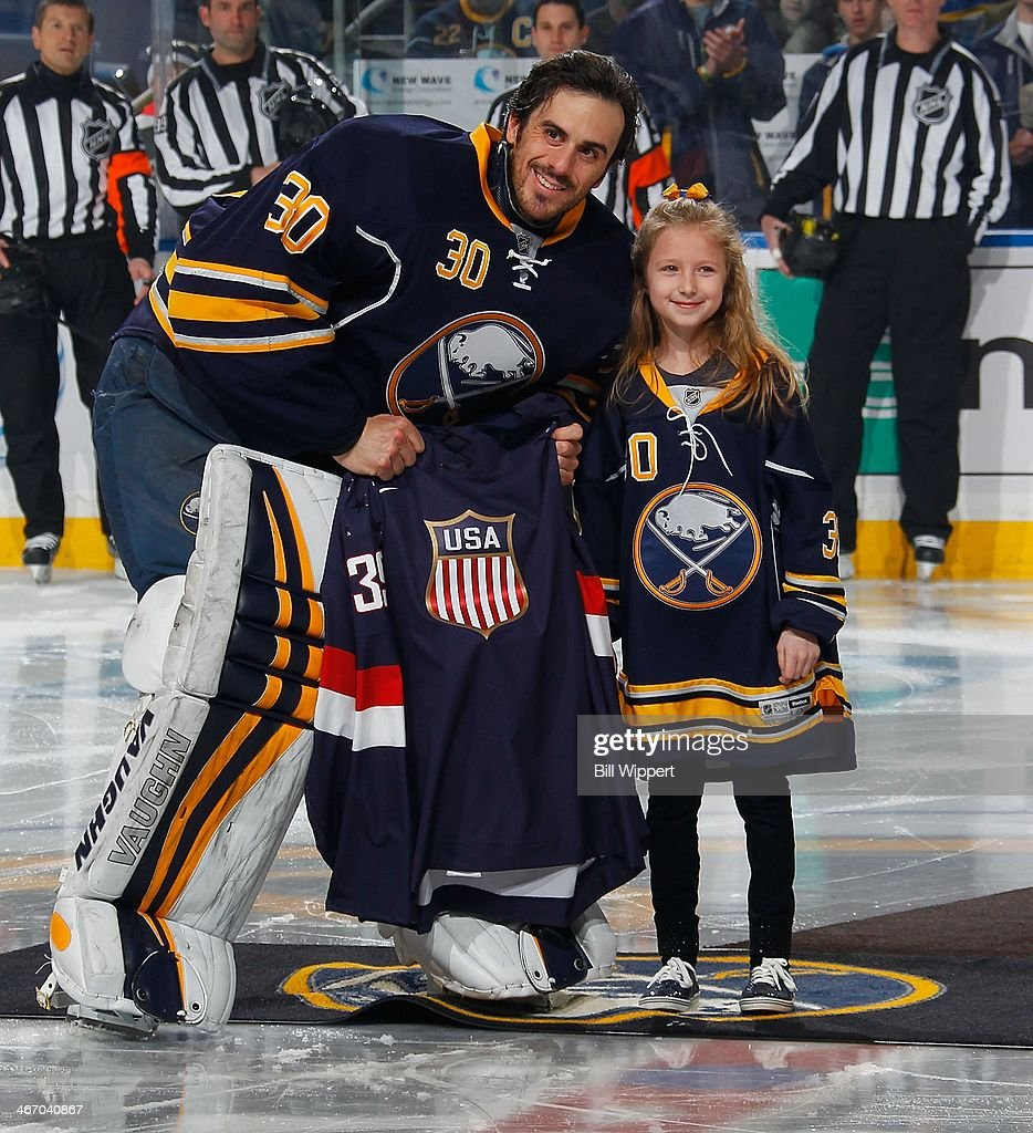 Ryan Miller #30 of the Buffalo Sabres receives a team USA Olympic jersey from a young fan during ceremonies prior to their game against the Pittsburgh Penguins on February 5, 2014 at the First Niagara Center in Buffalo, New York.