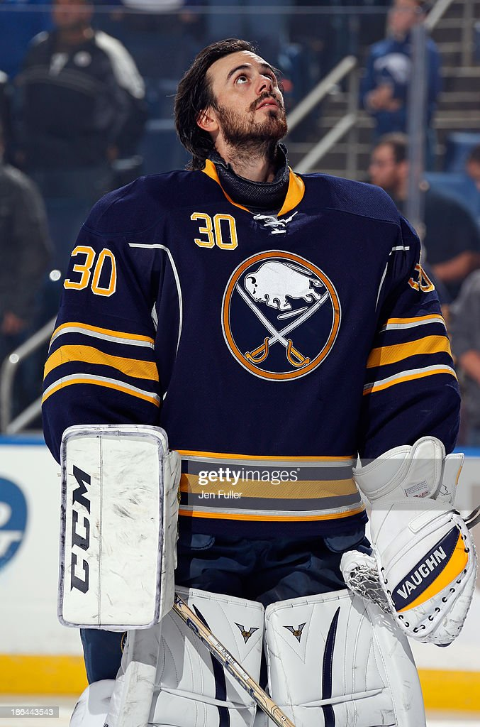 Ryan Miller #30 of the Buffalo Sabres stands on the ice during the singing of the national anthems prior to playing the Vancouver Canucks at First Niagara Center on October 17, 2013 in Buffalo, New York.