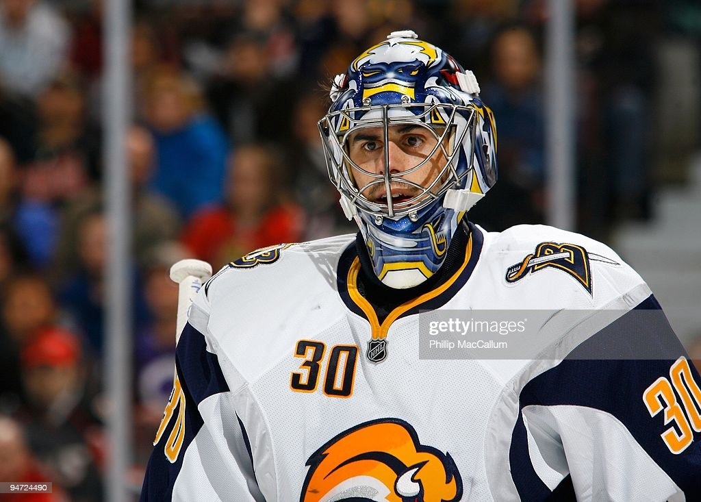 Ryan Miller of the Buffalo Sabres watches the play in the corner during a game against the Ottawa Senators at Scotiabank Place on December 16 2009 in...