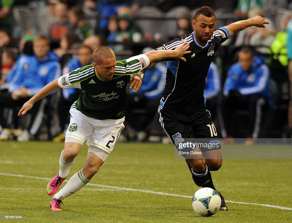 Ryan Miller #2 of the Portland Timbers battles for the ball with John Bostock #10 of San Jose Earthquakes during the first half of the game at Jeld-Wen Field on February 17, 2013 in Portland, Oregon.