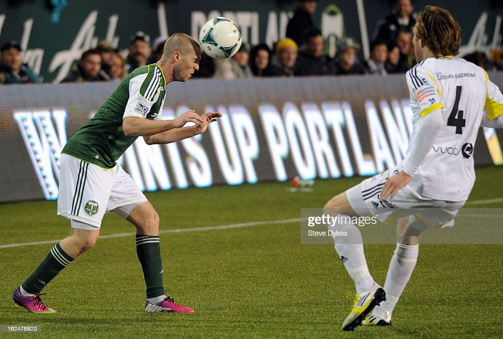 Ryan Miller #2 of the Portland Timbers heads the ball past <a gi-track='captionPersonalityLinkClicked' href=/galleries/search?phrase=Nils-Eric+Johansson&family=editorial&specificpeople=240698 ng-click='$event.stopPropagation()'>Nils-Eric Johansson</a> #4 of AIK during the second half of the game at Jeld-Wen Field on February 23, 2013 in Portland, Oregon. The game ended in a 1-1 draw.
