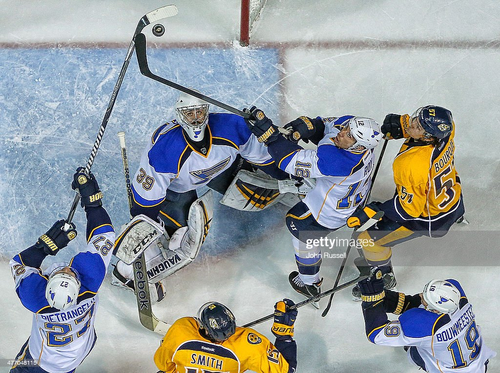 Ryan Miller #39 of the St. Louis Blues eyes the puck over his head against <a gi-track='captionPersonalityLinkClicked' href=/galleries/search?phrase=Gabriel+Bourque&family=editorial&specificpeople=5627917 ng-click='$event.stopPropagation()'>Gabriel Bourque</a> #57 of the Nashville Predatorsat Bridgestone Arena on March 6, 2014 in Nashville, Tennessee.