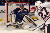 Ryan Miller of the St Louis Blues gives up a goal to Johnny Oduya of the Chicago Blackhawks in Game One of the First Round of the 2014 Stanley Cup...