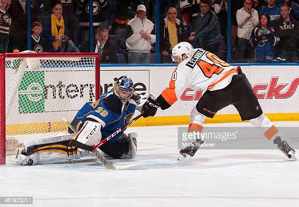 Ryan Miller of the St Louis Blues makes a save on a point blank shot from Vincent Lecavalier of the Philadelphia Flyers during the shootout in an NHL...