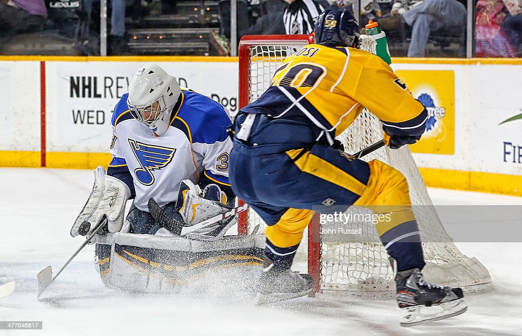 Ryan Miller #39 of the St. Louis Blues makes the save against <a gi-track='captionPersonalityLinkClicked' href=/galleries/search?phrase=Roman+Josi&family=editorial&specificpeople=4247871 ng-click='$event.stopPropagation()'>Roman Josi</a> #59 of the Nashville Predators at Bridgestone Arena on March 6, 2014 in Nashville, Tennessee.